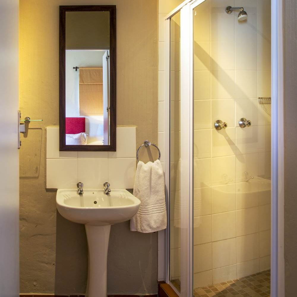 Bathroom at Cannon Rocks Beach Suites